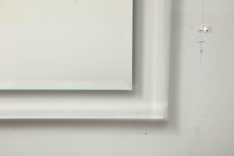 Mid-Century Modern Lucite framed mirror. Customization is available in different sizes.