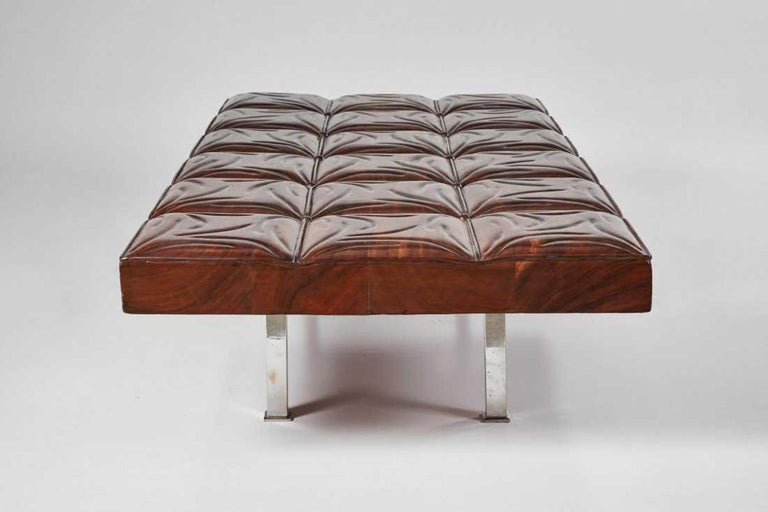 Mahogany and chrome hand carved gallery bench, 1970s.  Measures: 17 H x 77 W x 35 D inches.
