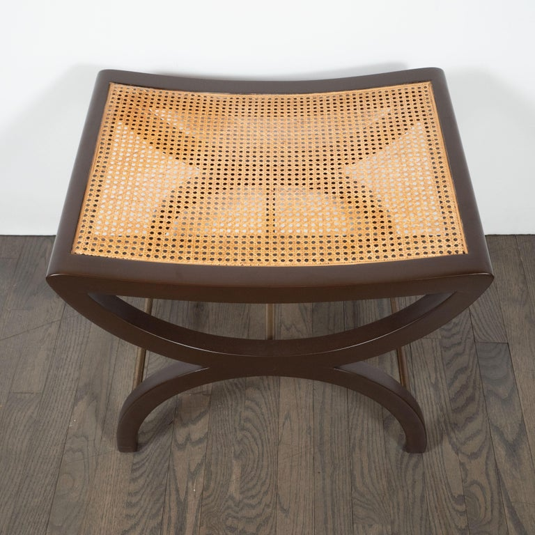 This elegant stool was designed by Edward Wormley for the Dunbar Furniture Company, circa 1960. Wormley, celebrated for the refined materiality and meticulous craftsmanship of his design pieces, created works that were thoroughly modern but often