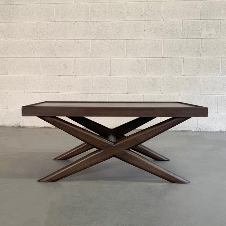 Beautifully proportioned, Mid-Century Modern, mahogany coffee table features a sculpted X-base with recessed top.