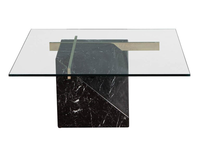 Mid-Century Modern marble brass & glass coffee table by Artedi. Black marble with white veining, glass and brass end table in original condition. Featuring new glass top.  Price includes complimentary curb side delivery to the continental USA.