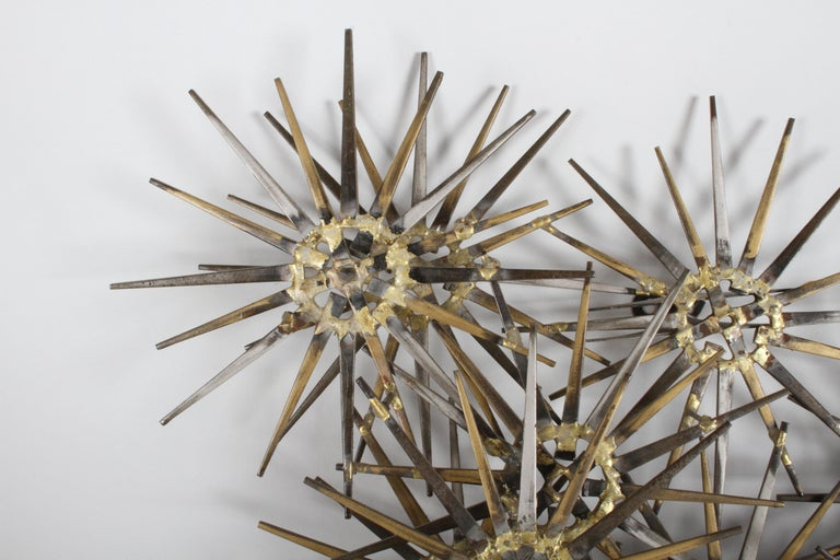 Wall sculpture by Marc Weinstein, cluster of stars with gold, silver and black paint. Signed Marc Creates, St. Louis Mo, in the manner of Curtis Jere, circa 1960s.