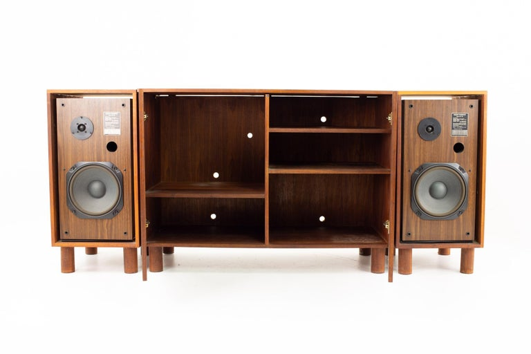Mid-Century Modern media console  Media cabinet measures: 45 wide x 19.5 deep x 33 high  Speakers measure: 15 3/4 wide x 19.5 deep x 33 high  This price includes getting this piece in what we call restored vintage condition. That means the