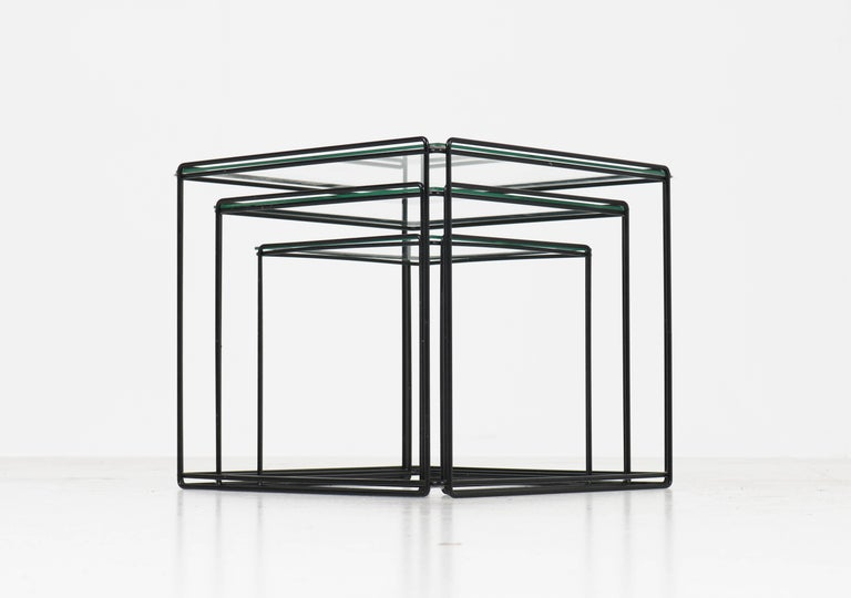 Wonderful set of three Mid-Century Modern nesting tables. Design by Max Sauze. Striking French design from the 1970s. Black lacquered metal frames with glass tops. In good original condition with minor wear consistent with age and