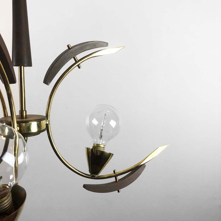 With 3-semi circles in brass and sculptural mahogany wood ornamentation, circa 1950. Amazing design, the lamp works.