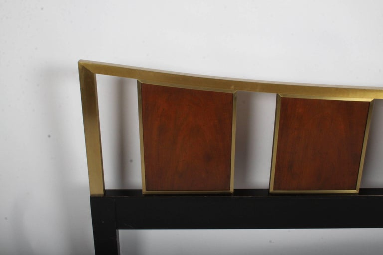 Michael Taylor for Baker king headboard with walnut, brass and ebony frame. Overall very nice original condition, but there are some scratches to the lower cross brace, they will not show once mattress is installed. Brass has minor patina. Label.