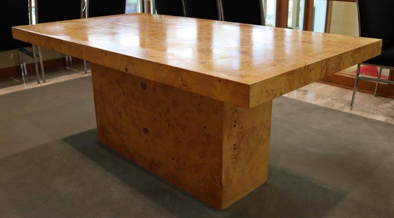 For your consideration is an exceptional, expandable, burlwood dining table, by Milo Baughman, with two leaves, circa the 1980s. In excellent vintage condition. The dimensions of the table are 71.5