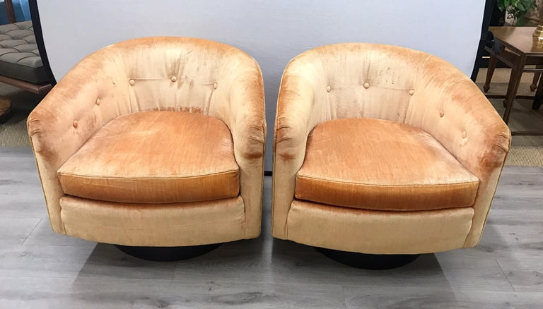 Gorgeous set of midcentury 360 degree swivel chairs with peach colored velvet upholstery.