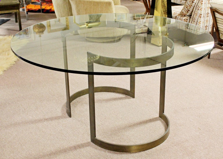 For your consideration is a stunning dining table, with two half moon bronze bases and a circular glass top, by Milo Baughman for Thayer Coggin, circa 1970s. In very good patinated condition. Base can also be used as a desk by putting a rectangular