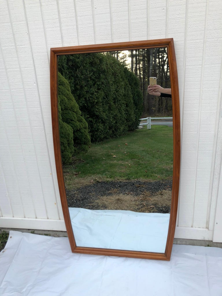 Large Mid-Century Modern mirror. Very large and unique in shape. Can be hung vertically or horizontally. Light wooden tone. Mirror width at top is 28