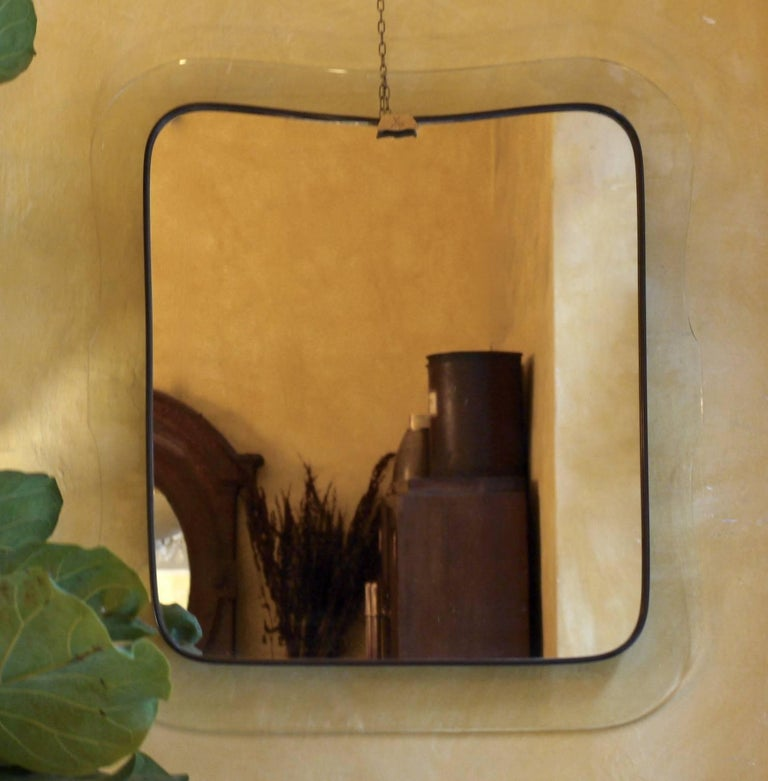 Luigi Fontana, before founding Fontana Arte, made this mirror in 1940 in Milan. Stamped with two crossed swords on the top front.