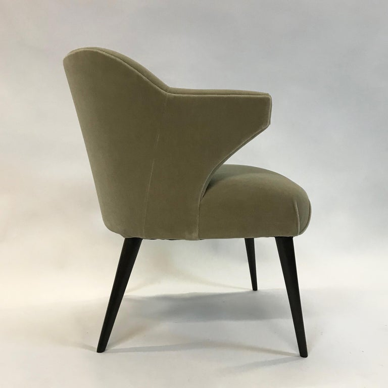 Stylish. Mid-Century Modern, wing arm, armchair is newly upholstered in a muted moss green mohair.