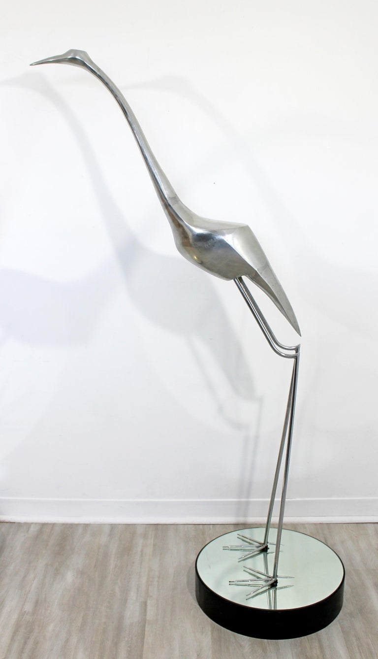 For your consideration is a monumental, aluminum and chrome floor sculpture of a heron, by Curtis Jere, circa 1970s. In excellent vintage condition. The dimensions are 36