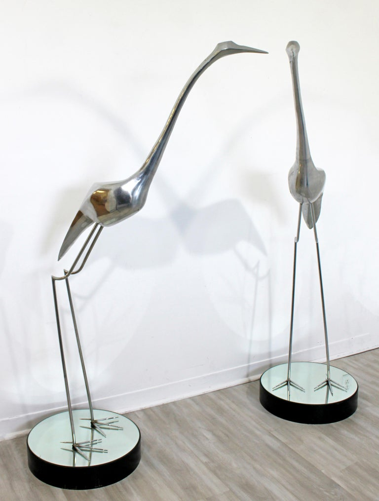 For your consideration is a monumental pair of aluminum and chrome floor sculptures of herons, by Curtis Jere, circa 1970s. In excellent vintage condition. The dimensions of each are 36