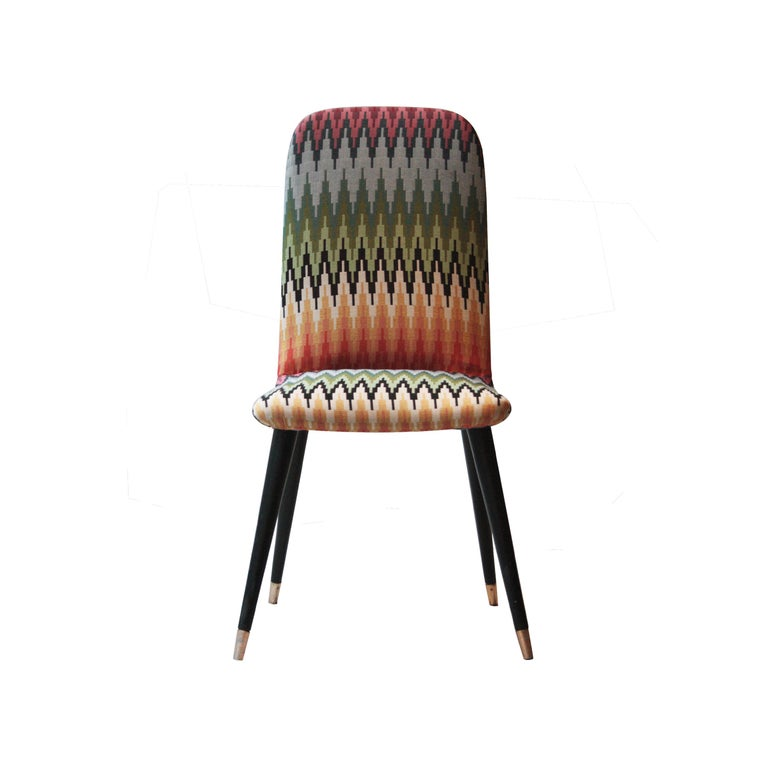 Italian couple of chairs with back and seat upholstered, legs finished in brass and reupholstered with geometric pattern.