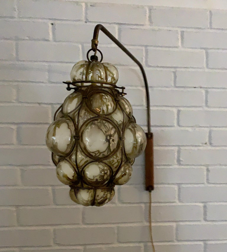 Mid-Century Modern Murano caged glass wall light, sconce, reading lamp, 1960s. Rare swinging wall lamp set up, gorgeous park aged metal neck with wood wall support.