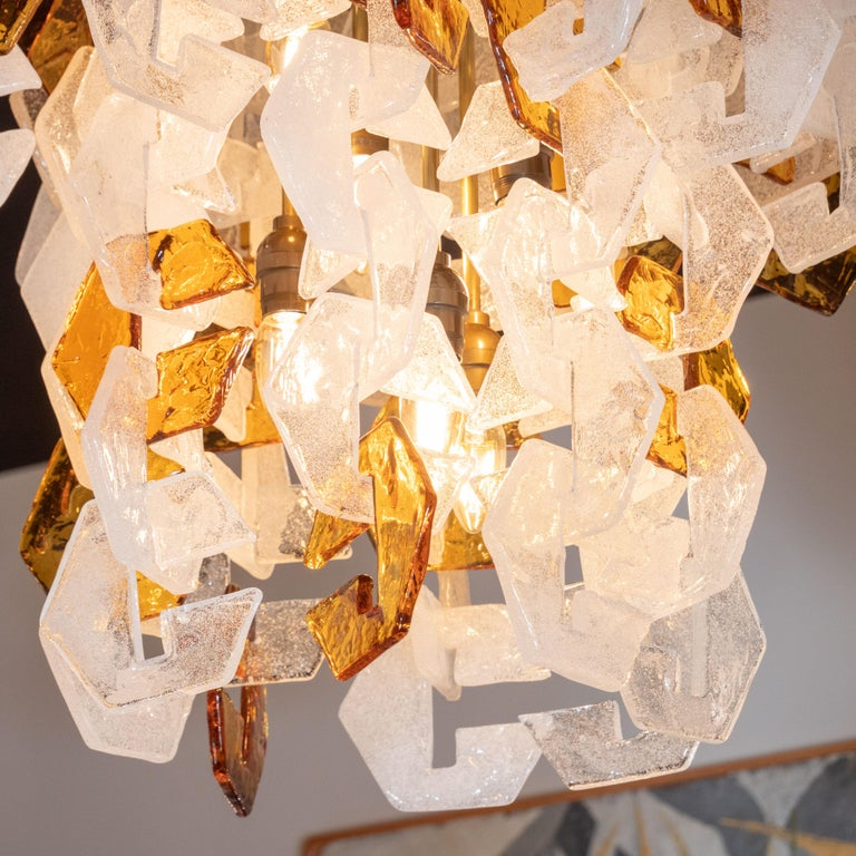 Brass Mid-Century Modern Murano Interlocking Amber and White Glass Chandelier, Mazzega For Sale
