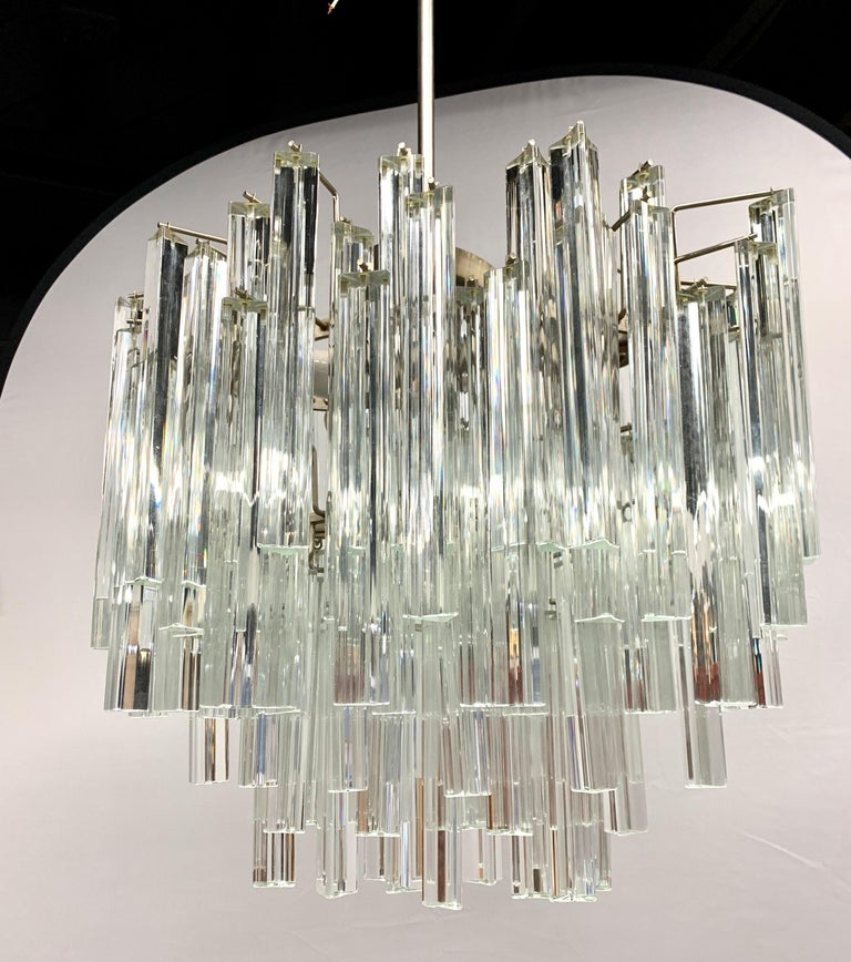 Stunning Camer Glass prism chandelier that features a metal rod and then a steel chain to the ceiling, see pics. Camer Glass chandeliers are true period pieces from the 1970s and have been featured in countless articles in Architectural Digest and