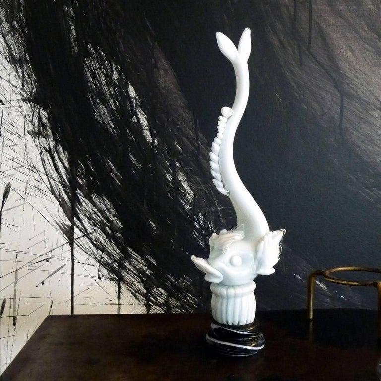 Mid-Century Modern Murano glass dolphin figurine, designed by Napoleone Martinuzzi in 1930 Dolphin in lattimo glass cased in crystal on stunted column base in lattimo, pedestal in vetro calcedonio. Engraved signature