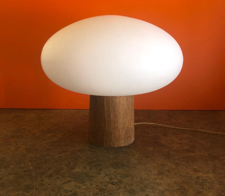 Highly collectible MCM mushroom table lamp on a solid teak base by Laurel Lamp Co., circa 1960s. The Italian mouth blown frosted glass mushroom shade is 12.5