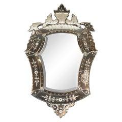 Mid-Century Modern Neoclassical Venetian Cartouche Form Chain Bevelled Mirror