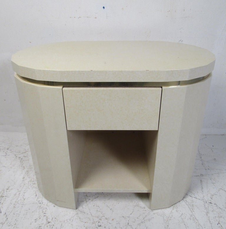 An unusual vintage modern nightstand with brass trim, a lacquered finish, and a large drawer. Perfect addition to any home, business, or office. Please confirm item location (NY or NJ).