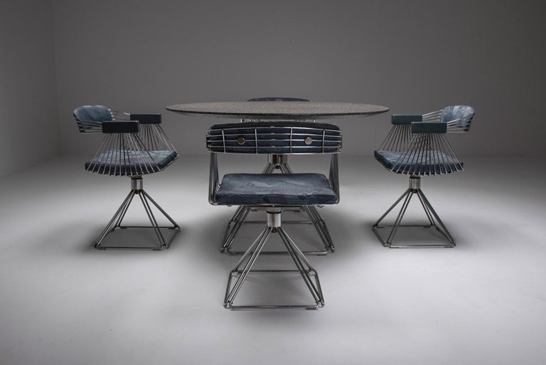 Space age dining set by Rudi Verelst for Novalux, Belgium, 1970s.  Chromed steel wire & swivel dining chairs  joined by the matching round dining table, which is super rare. The formica top shows a combination of black, white, red & brown
