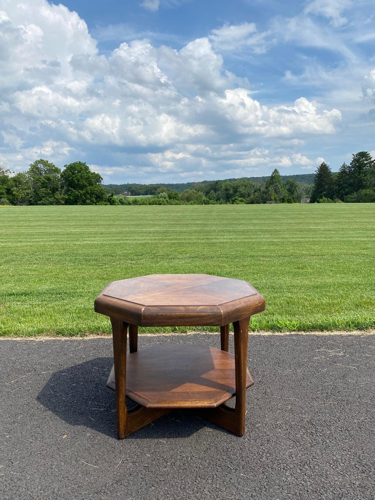Sculptural Mid-Century Modern octagonal side, end or drinks table by Lane Furniture. Sleek and stylish and very unique. Features gorgeous walnut wood frame with a beautiful parquetry table top and a second lower tier.   circa 1970s  Marked Lane