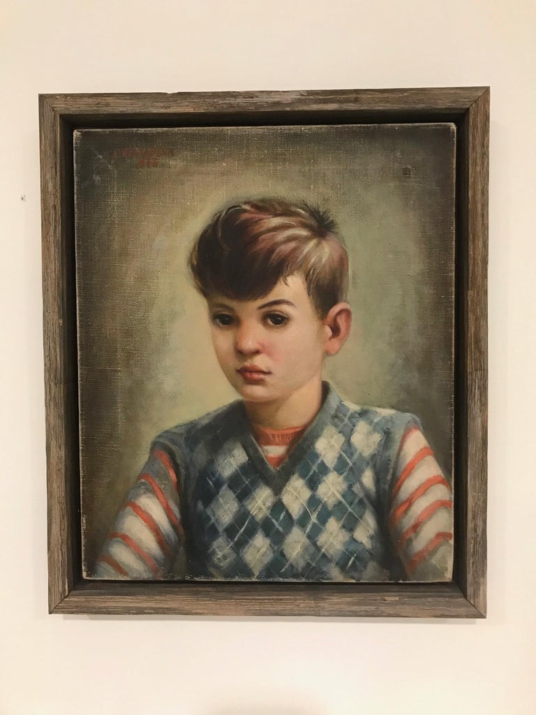 Vintage portrait of a young boy wearing a striped red shirt with blue argyle sweater. Oil on canvas painting by artist Robert Rukavina (1914-1977), who lived in the United States and is known for his realist figure and portrait artwork. There is a