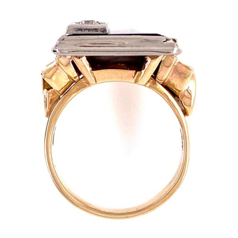 Onyx and Diamond 2-Tone Gold Tablet Ring top corner set with a .12ct Diamond, bottom and shank have retro scroll designs. The top is 14 Karat white gold and mounting is 14K Yellow Gold. The ring is super cool and unusual! Ring size 6.5, however, can