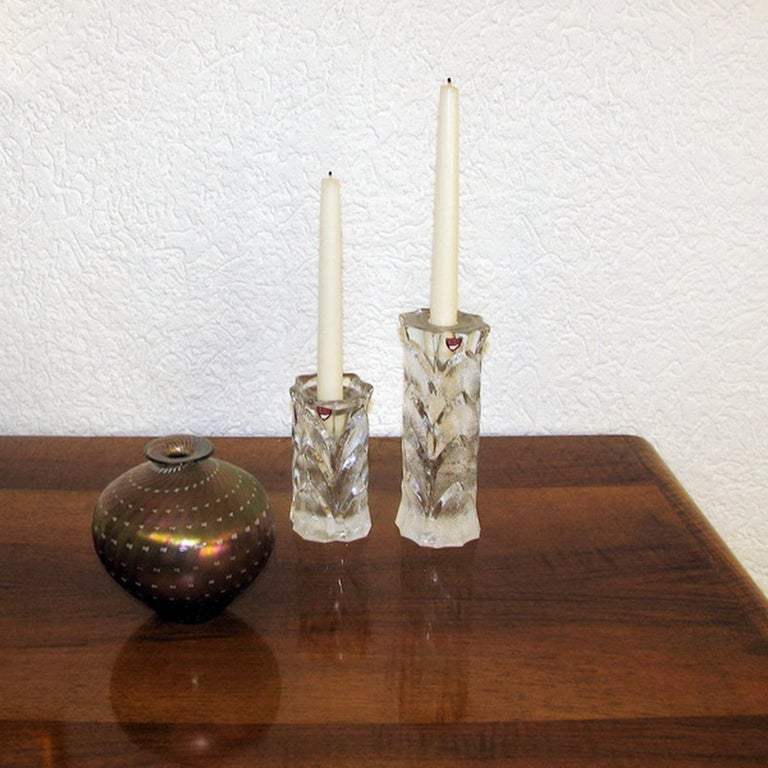 Vintage Orrefors crystal candleholders, nice relief surface vegetal motif, Sweden, 1970s. Heavy cast crystal, makers label to the front. Exceptional condition, some traces of stearin.
