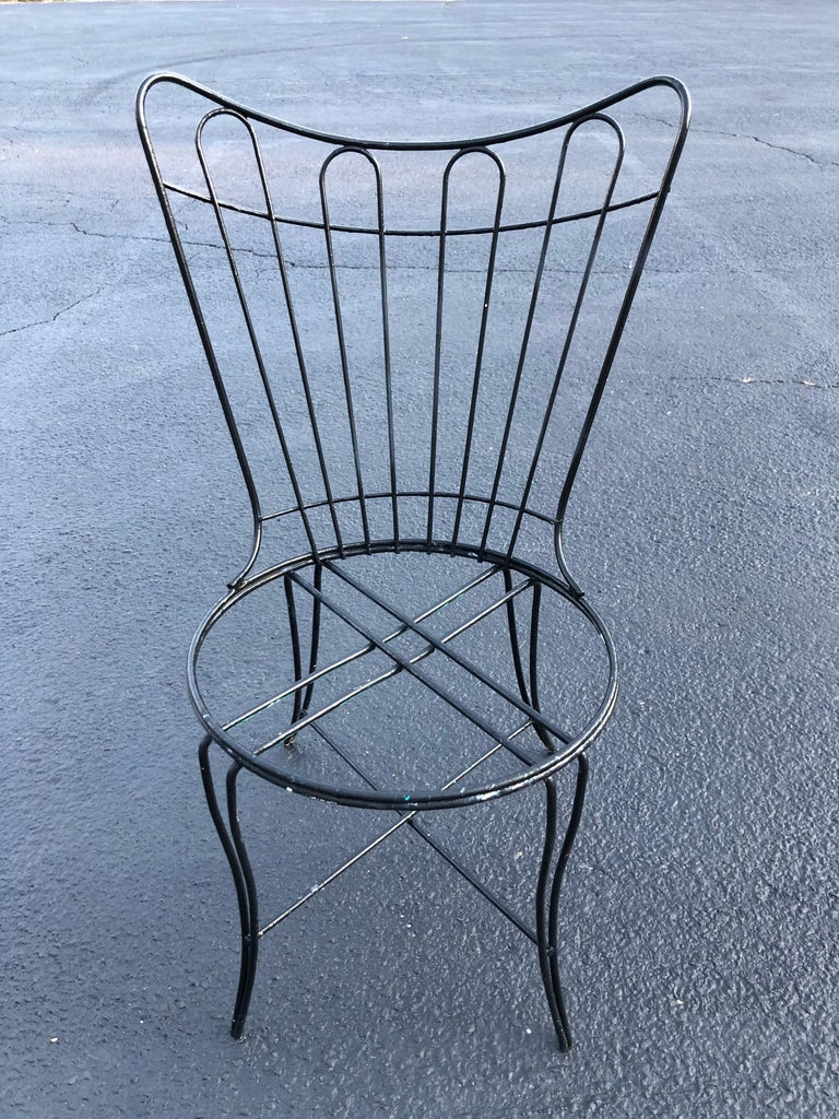 Mid-Century Modern outdoor patio chair by Homecrest. Black iron attributed to John Salterini for Woodard. Needs a cushion. Seat height without cushion 16.50