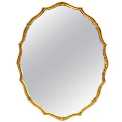 Mid-Century Modern Oval Mirror With Scalloped Gilt Wood Border