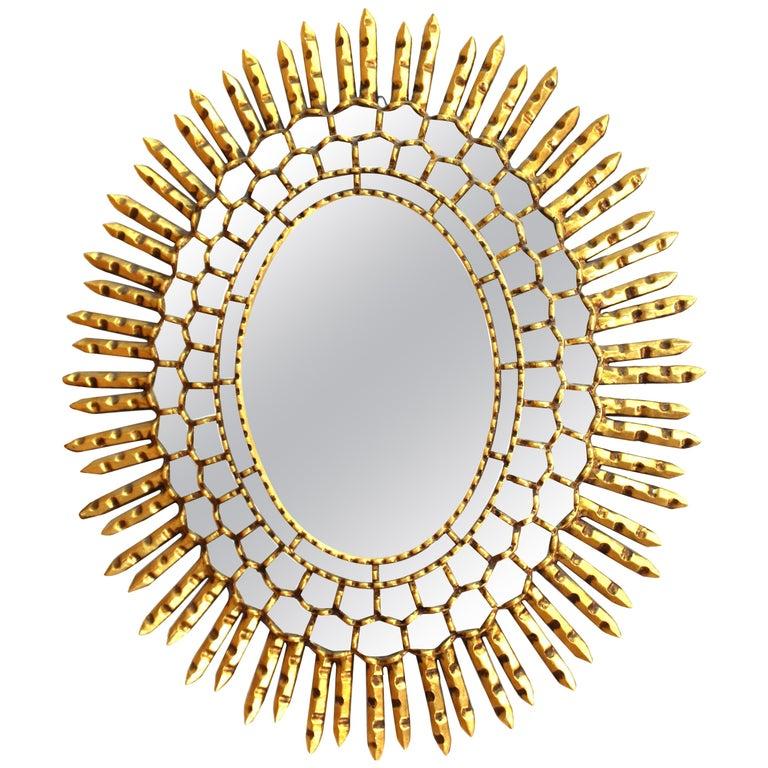 Mid-Century Modern Oval Sunburst Mirror in Giltwood For Sale