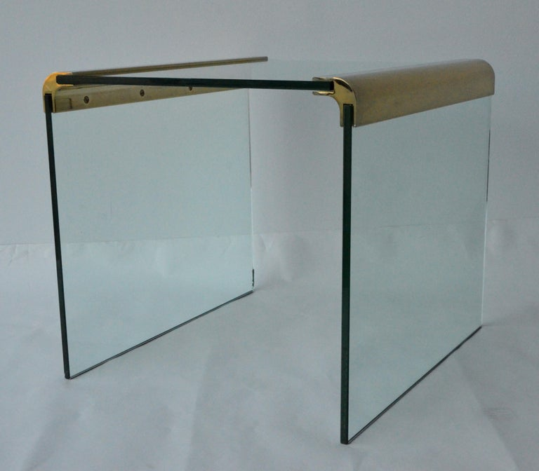 Offered is a Mid-Century Modern pace waterfall brass bar and three sided glass end or side table. Leon Rosen in York City founded pace and was in business from the 1970s-2001. The inimitable Rosen style used exotic wood veneers that had high-gloss