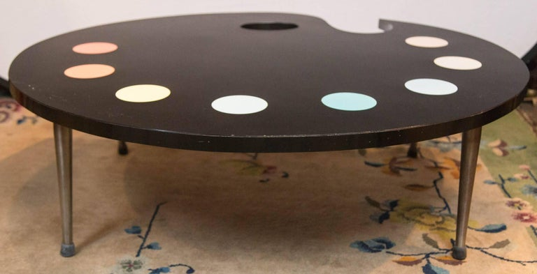 Fabulous 1950s whimsical painter's palette coffee table. The top is laminate. The legs are metal.