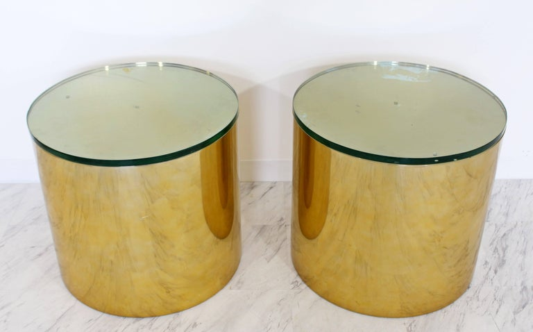For your consideration is an utterly fabulous, pair of brass polished aluminium, round drum side or end tables, with green glass tops, that were designed by Paul Mayen for Habitat International, circa 1970s. In great vintage condition, with some