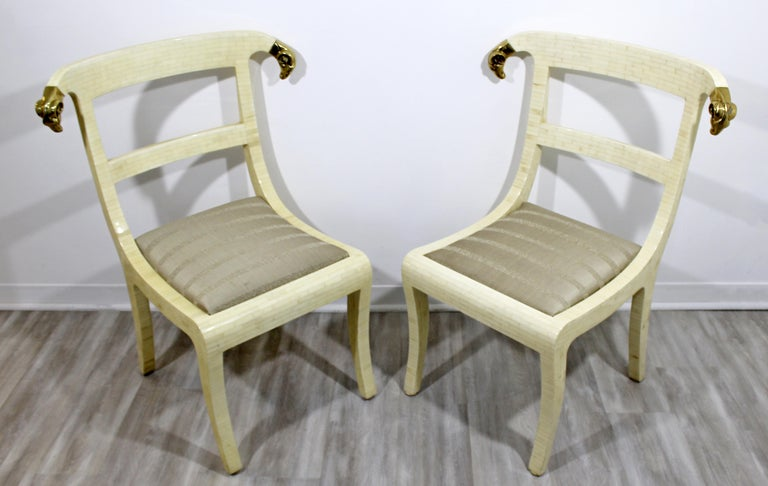For your consideration is a sensational pair of lounge accent chairs, made of tessellated stone and with brass rams head accents, for Jimeco, made in Colombia, circa the 1970s. In excellent vintage condition. The dimensions of each are 18.5