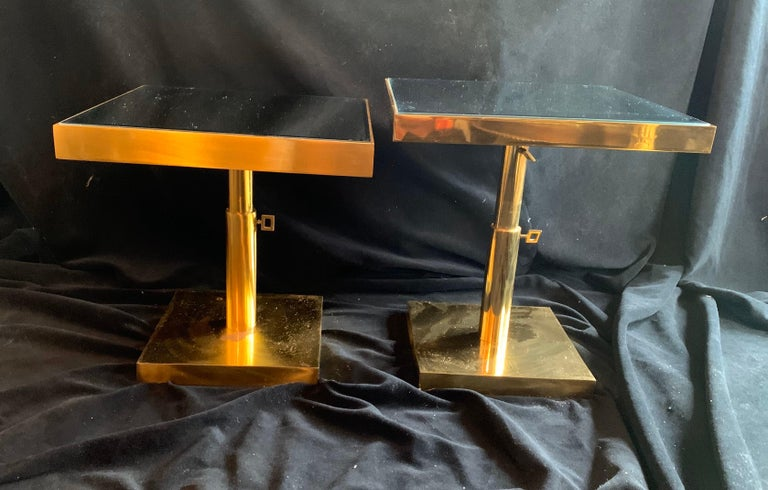 A wonderful pair of Mid-Century Modern bronze and beveled mirror, telescoping square side tables height is adjustable by 2 knobs. Purchased from Lorin Marsh showroom in New York City.