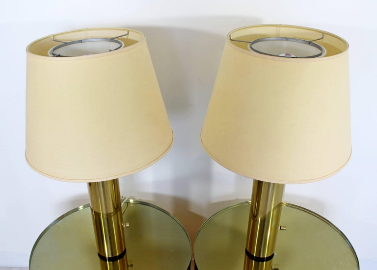 For your consideration is a fantastic pair of cylindrical brass, table lamps, in the style of Kovacs, circa the 1970s. In very good condition. The dimensions of the lamps are 8