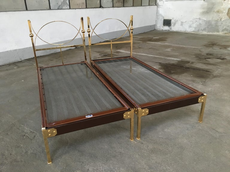Mid-Century Modern pair of Italian single beds with gilt brass headboard and feet, 1960s The beds need a mattress of cm. 80 x 190. One of the bed misses a short bar under the headboard as shown in the photo. In case of sell a brand new one will be