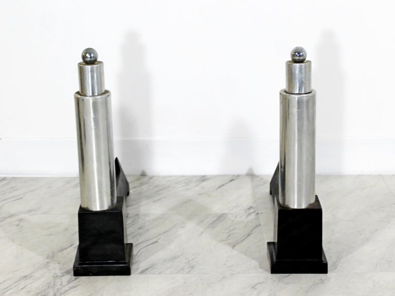 For your consideration is a wonderful pair of aluminum and iron andirons by Cutter. In excellent condition. The dimensions of each are 4