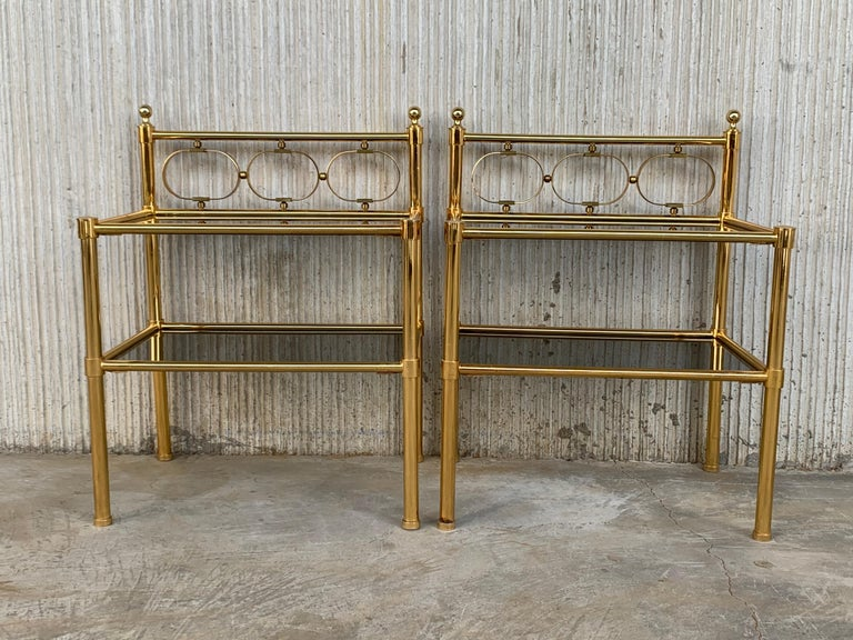 Mid-Century Modern pair of nightstands with two fumee glass shelves.