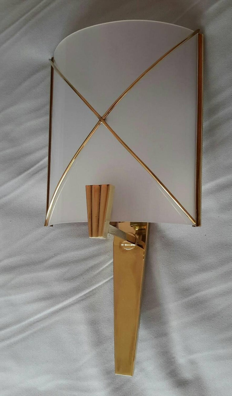 Beautiful and rare pair of French sconces mid-1950s in brass and perspex by Lunel.