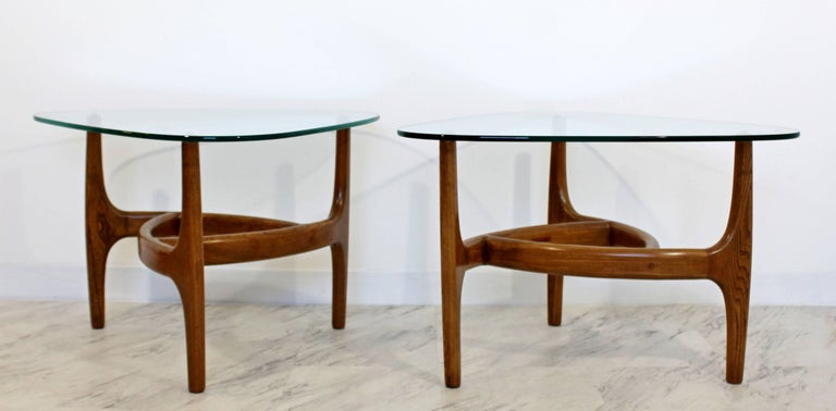 """For your consideration is a lovely pair of wood and glass side tables, in the style of Adrian Pearsall, circa the 1950s-1960s. In excellent condition. The dimensions of both are 31"""" W x 29"""" D x 21"""" H."""