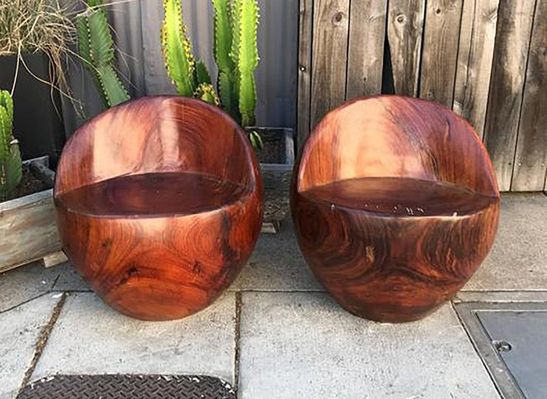 For your consideration a pair of round chairs constructed of solid block of exotic wood, unsure of the wood name, however is in the family of rosewood. 