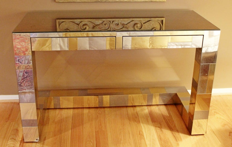 For your consideration is a marvelous desk, made of patchwork brass and chrome and a rosewood top, covered by glass, signed by Paul Evans for Directional, the Cityscape collection, circa 1970s. In good vintage condition. The dimensions are 48