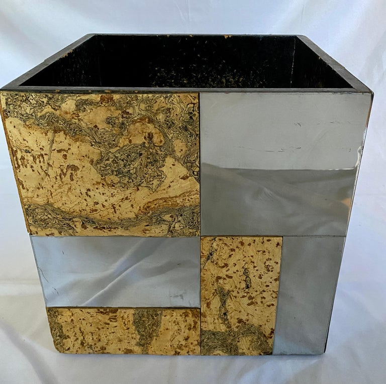 Large Mid-Century Modern cityscape planter vessel in the style of Paul Evans. This large square container features reflective polished chrome and cork panels. This versatile sculptural piece could be used as a planter, waste basket, or magazine