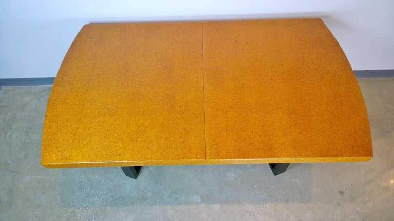 Offered is a Mid-Century Modern Paul Frankl clear lacquered cork top and carved mahogany wood base with two cork leaves dining table. This dining table is one of Paul Frankl iconic designs. Clean modern lines with the warmth of the cork and wood