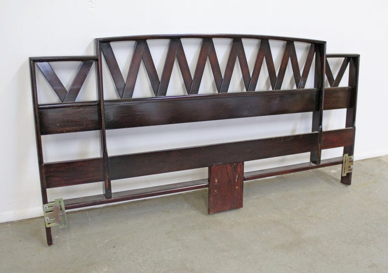 Offered is a vintage king size headboard with a zig-zag pattern designed by Paul Frankl. Looks to be walnut in a dark finish and shiny stain. It is in good structurally sound vintage with some surface scratches (see photos). Metal brackets were